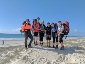 Students standing on the beach
