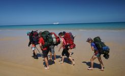 Duke of Edinburgh students hiking on beach