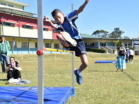 Student participating in Primary Sports