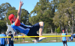 Student high jumping in secondary co-curricular activities.