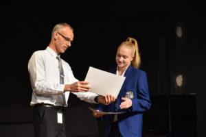 Athlete Natasha receiving award.