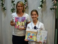 Emily Chester and Aleesah Darlison with artwork