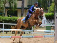 Jasmine and her showjumping horse JFK.