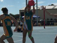 Sarah playing netball