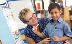 Teacher with an Infants program student