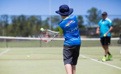 Student playing tennis in Primary Co-curricular sport program