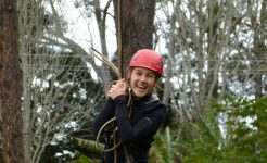 Student rock climbing in year level camps program